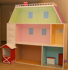 "6'x6' Dollhouse we made for our daughter's 18"" dolls. My hubby built this from his own plan that he created from our combined ideas. It includes a barn for her horse, drawers for storage, wooden floors and a pink chimney!"