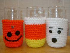 crocheted Halloween glass cozies. jack 'o lantern, ghost, & candy corn