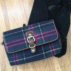 Plaid Clutch Plaid clutch bag purchased from target years ago. About 5 inches across and an inch wide. Closes with a magnetic closure. Has two interior pockets, one with a zip. Like new condition. Merona Bags Clutches & Wristlets