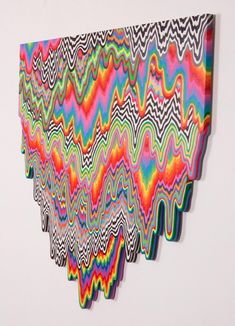 This is a good example of MOVEMENT because the optical illusion is making it look like the picture is sliding off of the wall.