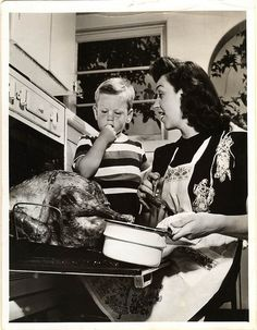 1950s anon Acme photo agency - mom basting thanksgiving turkey - front by blacque_jacques, via Flickr