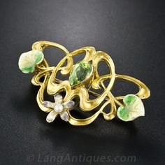 Art Nouveau Peridot and Enamel Pin - 50-1-2906 - Lang .Antiques 14K Yellow gold diamond starburst pin highlighting one old European cut diamond weighing .90 carat (SI1 clarity, H-I color) accented by thirty five old European cut diamonds (4.60 carats total weight, I-J color, VS-I1 clarity) radiating out in the rays. This pin may also be worn as a pendant and measures 1 1/2 inches.