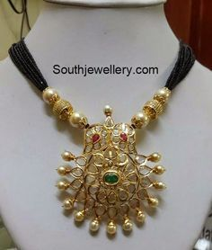 Multi string black beads necklace with 22 carat gold pacchi pendant studded with uncut diamonds, rubies, emerald and south sea pearls. Gold Jewellery Design, Bead Jewellery, Pendant Jewelry, Beaded Jewelry, Beaded Necklace, Baby Jewelry, Ruby Necklace, Pearl Necklaces, Latest Jewellery