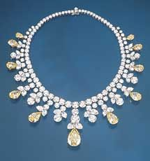The Louis Glick necklace/tiara features fancy yellow and white pear-shaped diamonds and white brilliants. The center diamond is 20.15 carats. Total diamond weight: 106.28 carats.