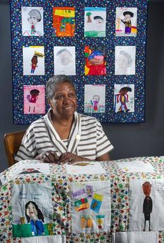 Well-known Kansas City quilt artist Nedra Bonds appears with some of the quilts created by elementary school children in Kansas City, Kan., ...