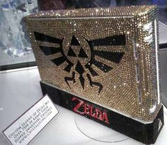 The Legend of Zelda-themed crystal Wii probably cost more than a few months' mortgage payments. It's been carefully detailed with over 7500 24-Karat gold-dipped crystals. WOW