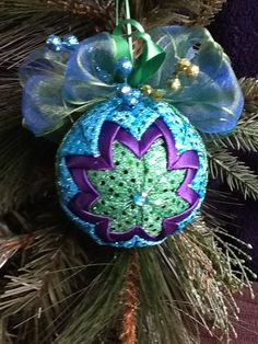 Sequined quilted ornament...250 straight pins, 2 hours to make....
