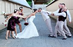 funny wedding photos ideas, might be even better to have the bridesmades holding the groom back while the groomsmen cheer him on, bride to the side, then a second picture with the pastor with signed certificate, then bridesmades give up, then a kiss pic!?