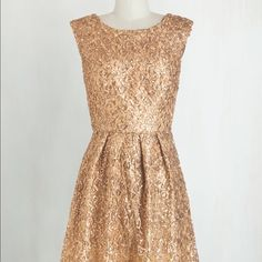 Gold sequin dress Adorable retro cocktail dress! I wore it one time as a bridesmaid for my best friend's wedding. I am busty so if you are a curvy girl you will love it. 100% polyester ModCloth Dresses Midi