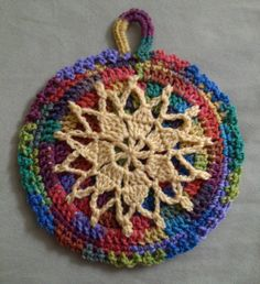Colorful trivet made by Tangles.  These are actually 2 sewn together and can be reversible.  The back is plain.