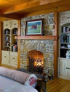 Stone fireplace with bookshelves on each side is beautiful for living area or bedroom.