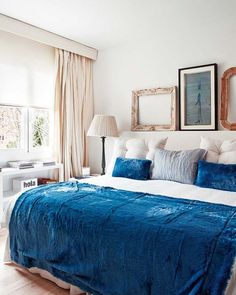 Velvety blue bedding in an otherwise neutral bedroom.