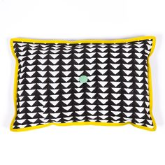 ARRO Home: Linen cushion in Mono Triangle print. Black design on white base with contrasting yellow piping border and a centred pom pom detail.  •   Dimensions: 25cm X 40cm