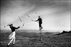 Circus jugglers Denis Thorpe Ulverston, UK A surreal image created when Fleur Laverack and Jem Hulbert were rehearsing juggling and unicycling on a frosty morning on the hills overlooking Morecambe Bay above Ulverston, Cumbria. Old Circus, Night Circus, Pedro Martinelli, Steampunk Circus, Above The Line, Unicycle, Epic Photos, Commercial, Magnum Photos