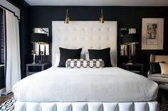 Dark walls light bedding