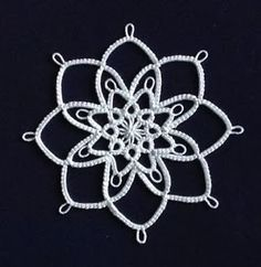 """Jack Frost Snowflake designed by Darlene Polachic, published in """"Big Book of Tatting"""" by House of White Birches. I know snowflakes should h. Shuttle Tatting Patterns, Needle Tatting Patterns, Crochet Motif, Crochet Stitches, Needle Tatting Tutorial, Tree Tat, Bead Sewing, Crochet Snowflakes, Thread Art"""
