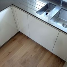 French solid oak flooring fitted in Contemporary Kitchen. Chateau Vanilla finish  Fine Oak Flooring