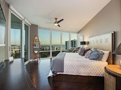 Bedroom with a view - Park Shore - Naples, Florida - wood floors - floor to ceiling windows - view of the bay