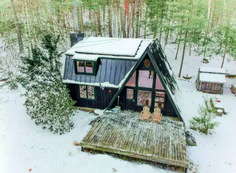 If you're dreaming about having a cabin vacation, check out this modern A-frame cabin rental destination for inspiration and start planning your next outdoor adventure. Build A Frame, A Frame Cabin, A Frame House Plans, Ideas De Cabina, Cabin In The Woods, Barn Parties, Log Cabin Homes, Rustic Design, Renting A House