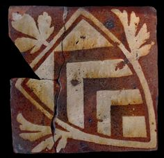 Medieval tile with the de Clare family coat of arms at Glastonbury Abbey, England.