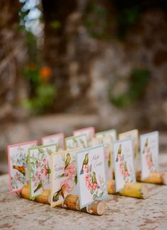 Tropical bird print escort cards propped up with slitted Hawaiian bamboo stalks