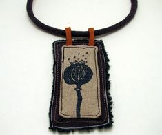 Poppyhead fiber necklace by Morgen Bardati
