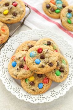 These are AMAZING - instead of M&M's I just used 1 package of semi-sweet chocolate chips. Soft and chewy cookies filled with M&Ms and chocolate chips. These M&M Chocolate Chip Cookies are easy to make and turn out perfect every time! Smartie Cookies, M&m Cookie Recipe, Peanut Butter Cookie Recipe, Easy Cookie Recipes, Yummy Recipes, Recipies, Chocolate Chip M&m Cookies, Smarties Chocolate, Bon Appetit
