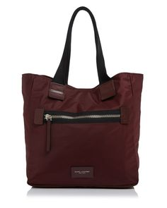 Zip hardware and stitched leather accents bring biker-inspired edge to this super-spacious Marc Jacobs tote. | Nylon; foam: polyethylene | Imported | Double handles   | Top snap closure; lined | Exter