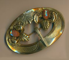 Image Copyright RC Larner ~ Brooch  Large Early 20th C. Saphiret Glass in Brass Sash Pin   ~ R C Larner Buttons at eBay & Etsy        http://stores.ebay.com/RC-LARNER-BUTTONS and https://www.etsy.com/shop/rclarner
