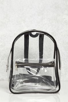 A clear backpack featuring contrast faux leather trim, a zippered top, adjustable shoulder straps, and a front zippered pocket.