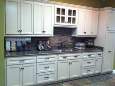 Display I did at work - Cambria Quartz and porcelain tile floors and backsplash (Made to look like slate) Contemporary Gray Cabinets