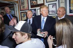 Republican presidential candidate Donald Trump greets people before speaking to reporters at the Red Arrow...