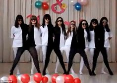 Girls in black-and-white outfits create brain scrambling dance video - As they moved together with the music, it appeared as if a pair of legs belonged to one person