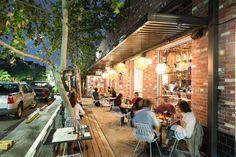 Lantern lights give the side patio of Cuchara a soft, warm glow.