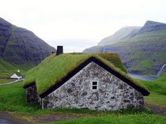 old school green roof-looks like places i saw in the Faroe Islands