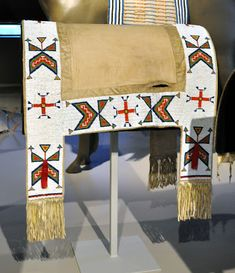 As promised, here are some more photos from the Native American saddlery collection at the Denver Art Museum. This woman's saddle was create. Native American Horses, Native American Regalia, Native American Artifacts, Native American Beadwork, Native American Fashion, American Indian Crafts, Horse Mask, Indian Horses, Horse Costumes