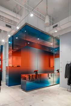 Discover the selection of the 15 best design projects of the Summer 2018 in terms of furniture interiors and digital architecture Alchemist store Rene Gonzalez X German Ermics tie and dye mirrored glass blue glass orange glass red glass st Office Interior Design, Office Interiors, Home Interior, Design Interiors, Showroom Design, Interior Design Exhibition, Color Interior, Interior Shop, Corporate Interiors