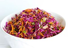 How much do you love spicy food? Heres a healthy spicy slaw you can try! You can eat this before or after your workout! Give a try! & comment down how was it. Ingredients head purple cabbage shredded 1 bunch cilantro finely chopped 1 carrot grated 1 jalapeño pepper seeded and minced 1 teaspoon minced ginger 2 limes juiced 2 tablespoons olive oil 7 drops stevia teaspoon celtic sea salt Instructions - Place the cabbage cilantro carrot jalapeño and ginger in a large bowl - Toss veggies with…