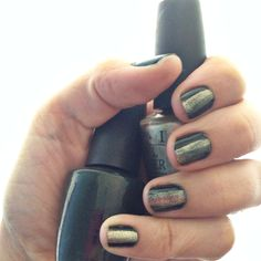 Hunter Green with a Gold stripe for sheen. This would probably look great with red or black too. OPI Here Today...Aragon Tomorrow & Glitzerland www.thismomsgonnasnap.com