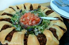 Taco ring. The kids loved this.  I subbed the store bought rolls for home made bread dough. Really good.