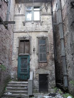by Prodom .    This is an abandoned house I found hidden in a backyard of an apartment building. I was amazed by its facade and managed to get inside climbing between the two brick walls (right side of photo, very close to each other houses) and get inside through a window.I will return there to haunt the second house as well, but also have a lot of target through the city.