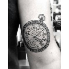 fine line pocket watch tattoo. great detail.