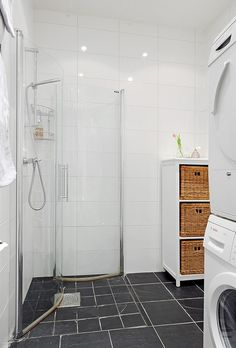Shower doors fold back to open up the bathroom/ laundry room until needed!
