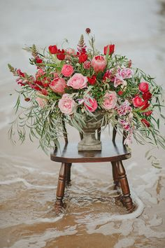 Such a GORGEOUS red and pink floral arrangement full of olive brand greenery!