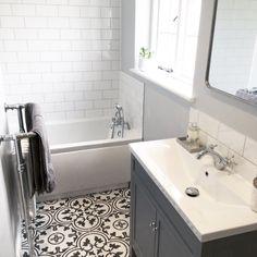 Grey bathroom white metro tiles with black and white floor tiles. Photo by @poms_abode
