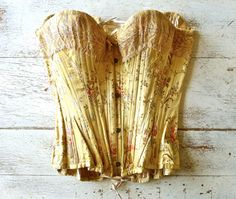 Exquisite French Satin Brocade Corset  Beautiful french corset circa 1890s. Embroidered satin fabric with lace detailing at bust and ivory lining.
