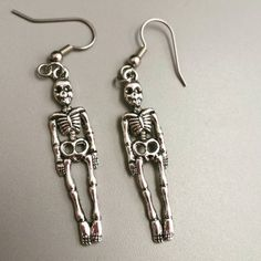 Check out this item in my Etsy shop https://www.etsy.com/listing/482222785/skeleton-earrings-skeleton-jewelry