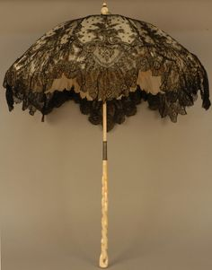 ladylimoges:    lostintherenaissance:    whattheywore:      Folding chantilly lace parasol with carved ivory handle, 1870's