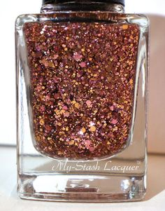 Tried this out over a black base coat and SHA-BAM!, talk about a stunner! Los like somebody foiled my nails with Rose Gold! WOW! LOVE My Stash!  Copper ThiefGlitter Nail Polish by MyStashLacquer on Etsy