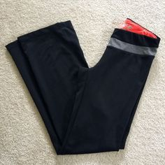 "New Balance LightningDry Bootcut Performance Pants New Balance Lightning Dry Bootcut Performance Pants Color: Black with Gray trim on the front, neon orange interior waist band. Size Small Fabric: 87% Polyester 13% Spandex Inseam: 31"" In excellent condition  Retail price $45 New Balance Pants Track Pants & Joggers"